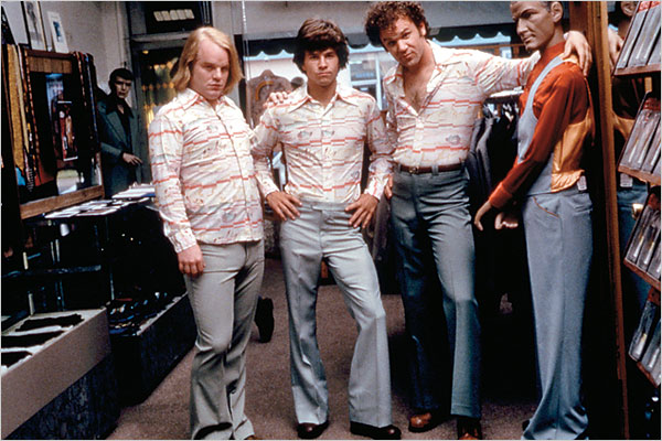 Porn family (Philip Seymour Hoffman, Mark Wahlberg and John C. Reilly) goes shopping in Boogie Nights