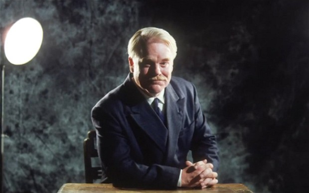 Philip Seymour Hoffman as Lancaster Dodd in The Master