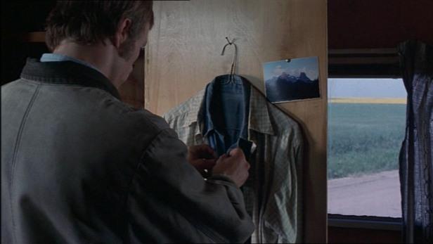 Ennis in his closet tending to his broken heart