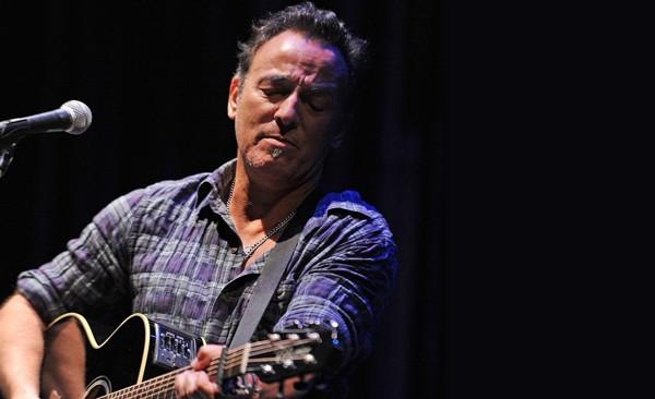 Bruce Springsteen plays guitar