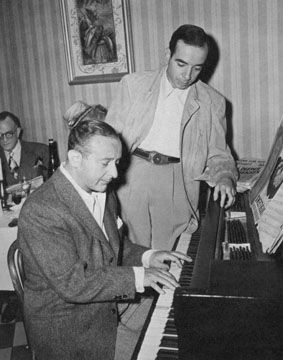 Arthur Freed (at the piano) with director Vincente Minnelli