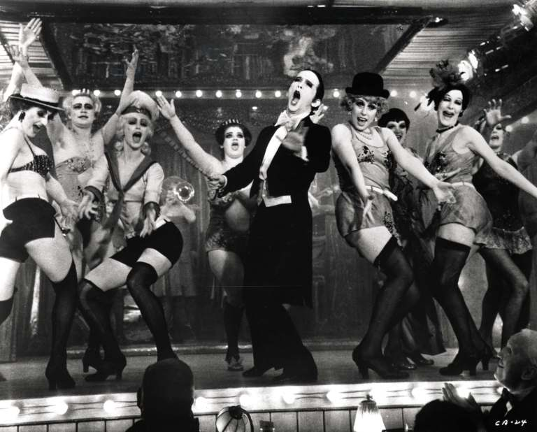 Emcee and the 'beautiful' Kit Kat Club dancers welcome you to cabaret