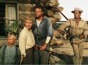The Starrett family – Joey, Marian and Joe – with Shane behind them