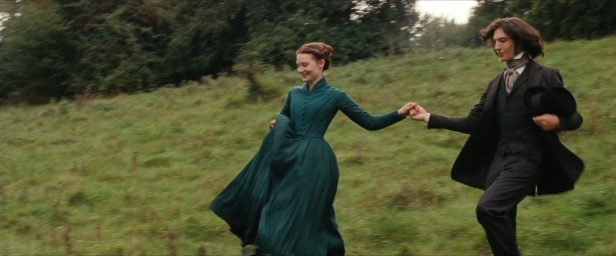 Emma running towards romance with one of her lovers, Leon (Ezra Miller).